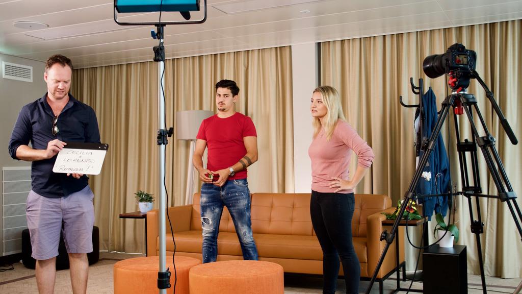 Actors filming in the living room set