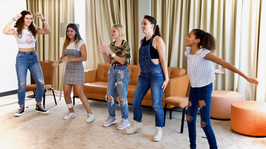 A group of talented actresses participating in a improv exercise