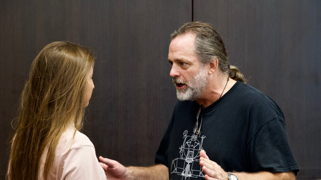 Acting Coach Jonathan Goldstein coaching an actress before she goes on stage